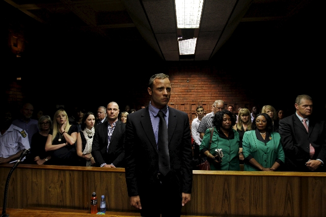 """""""Blade Runner"""" Oscar Pistorius awaits the start of court proceedings in the Pretoria Magistrates court, in this file picture taken February 19, 2013. (Siphiwe Sibeko/Files/Reuters)"""