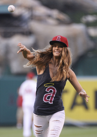 Sports Illustrated Swimsuit model Nina Agdal throws out the first pitch before the game between the Chicago White Sox and the Los Angeles Angels at Angel Stadium of Anaheim, Aug 17, 2015. (Richard ...