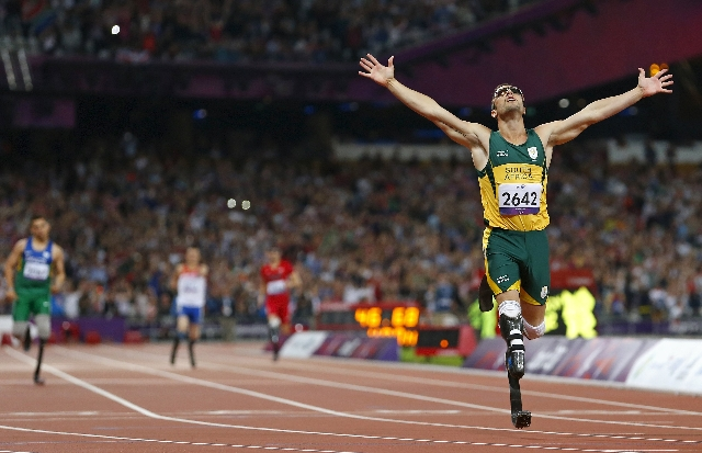 Oscar Pistorius of South Africa celebrates winning the Men's 400m T44 Final during the London 2012 Paralympic Games at the Olympic Stadium in London in this September 8, 2012 file photo. Pis ...