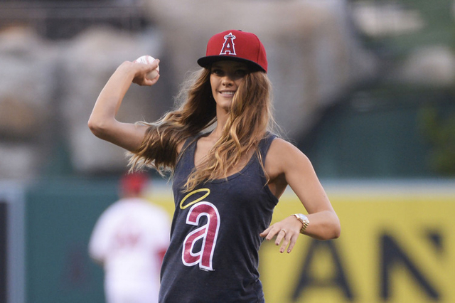 Sports Illustrated Swimsuit model Nina Agdal throws out the first pitch before the game between the Chicago White Sox and the Los Angeles Angels at Angel Stadium of Anaheim, Aug. 17, 2015. (Richar ...