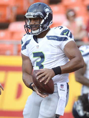 Aug 21, 2015; Kansas City, MO, USA; Seattle Seahawks quarterback Russell Wilson (3) warms up prior to the game against the Kansas City Chiefs at Arrowhead Stadium. (John Rieger/USA Today Sports)