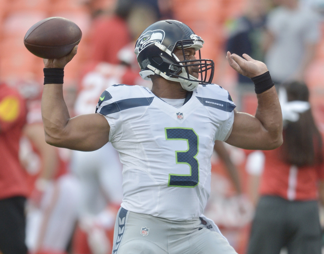 Aug 21, 2015; Kansas City, MO, USA; Seattle Seahawks quarterback Russell Wilson (3) warms up prior to the game against the Kansas City Chiefs during the first half at Arrowhead Stadium. (Denny Med ...