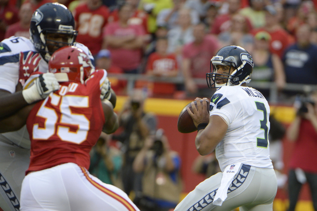 Aug 21, 2015; Kansas City, MO, USA; Seattle Seahawks quarterback Russell Wilson (3) prepares to throw the ball against the Kansas City Chiefs in the first half at Arrowhead Stadium. (John Rieger/U ...