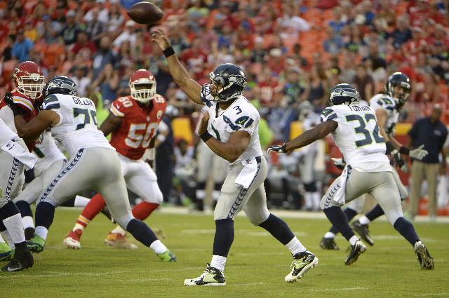 Aug 21, 2015; Kansas City, MO, USA; Seattle Seahawks quarterback Russell Wilson (3) throws a pass against the Kansas City Chiefs in the first half at Arrowhead Stadium. (John Rieger/USA Today Sports)