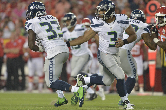 Aug 21, 2015; Kansas City, MO, USA; Seattle Seahawks quarterback Russell Wilson (3) hands off to running back Christine Michael (33) during the first half at Arrowhead Stadium. (Denny Medley/USA T ...