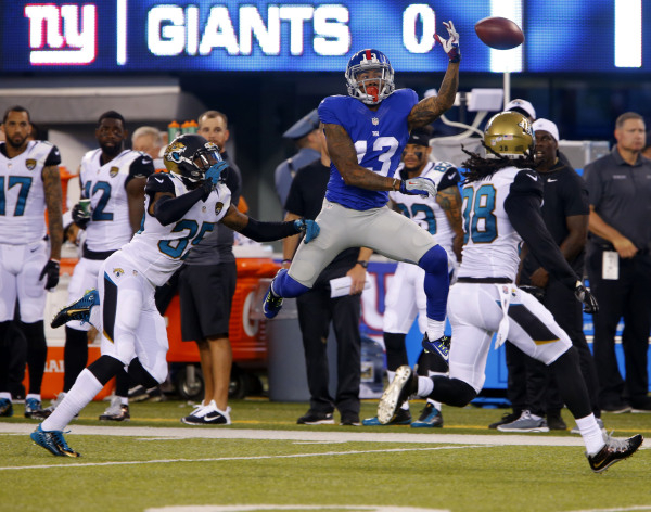 Giants wide receiver Odell Beckham Jr., center, didn't let many passes slip through his grasp last season, when he caught 91 passes for 1,305 yards and 12 touchdowns in 12 games. The acrobat ...