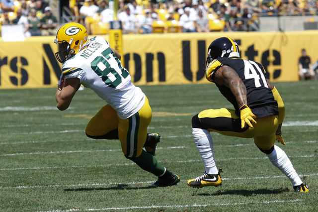 Aug 23, 2015; Pittsburgh, PA, USA; Green Bay Packers wide receiver Jordy Nelson (87) runs after a pass reception against Pittsburgh Steelers defensive back Antwon Blake (41) during the first quart ...