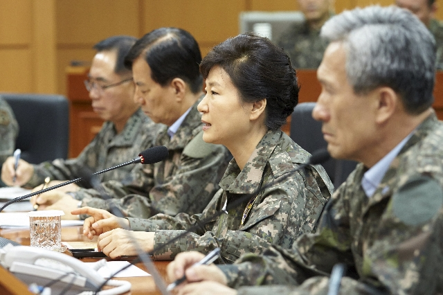 South Korean President Park Geun-hye (C) speaks during her visit to a military command post in Yongin, South Korea, in this handout picture provided by the Presidential Blue House and released by  ...