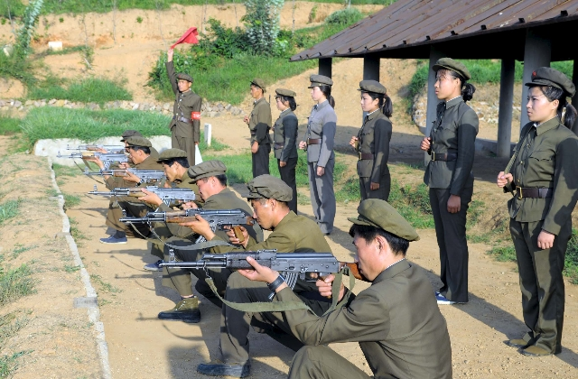 North Koreans who signed up to join the army train in the midst of political tension with South Korea, in this undated photo released by North Korea's Korean Central News Agency (KCNA) in Py ...