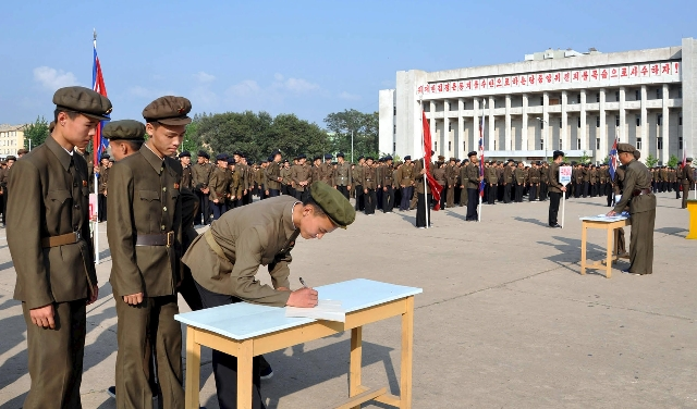 North Koreans sign up to join the army in the midst of political tension with South Korea, in this undated photo released by North Korea's Korean Central News Agency (KCNA) in Pyongyang Augu ...
