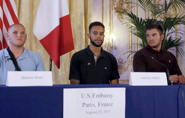 U.S. ambassador to France Jane Hartley (not pictured) presents  U.S Airman First Class Spencer Stone, left, student Anthony Sadler and National Guardsman Alek Skarlatos as they attend a ceremony a ...