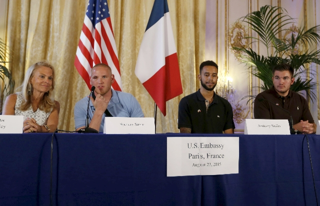 U.S. ambassador to France Jane Hartley presents U.S Airman First Class Spencer Stone, left, student Anthony Sadler and National Guardsman Alek Skarlatos as they attend a ceremony at the U.S. Embas ...