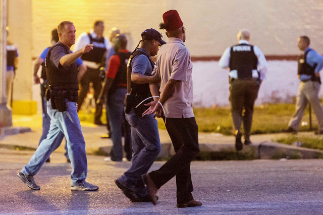 Police arrest a man as protesters gathered after a shooting incident in St. Louis, Missouri August 19, 2015. (Kenny Bahr/Reuters)