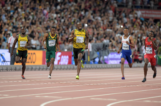 Aug 27, 2015; Beijing, China; Usain Bolt (JAM), center, wins the 200m in 19.55 during the IAAF World Championships in Athletics at National Stadium. From left: Nickel Asheade (JAM), Anaso Jobodwan ...