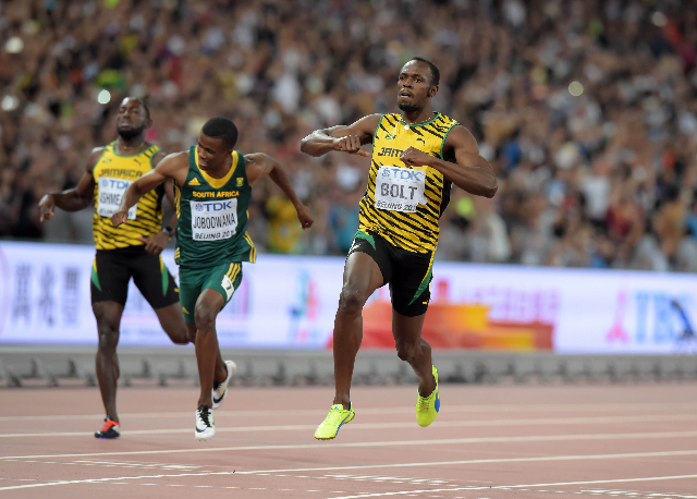 Aug 27, 2015; Beijing, China; Usain Bolt (JAM) wins the 200m in 19.55 during the IAAF World Championships in Athletics at National Stadium. From left: Nickel Asheade (JAM), Anaso Jobodwana (RSA an ...