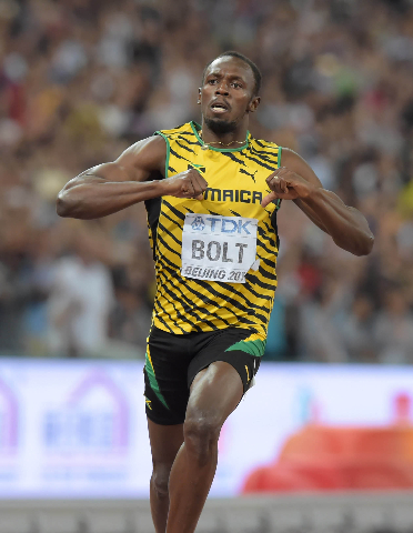 Aug 27, 2015; Beijing, China; Usain Bolt (JAM) celebrates after winning the 200m in 19.55 during the IAAF World Championships in Athletics at National Stadium. (Kirby Lee/USA Today Sports)