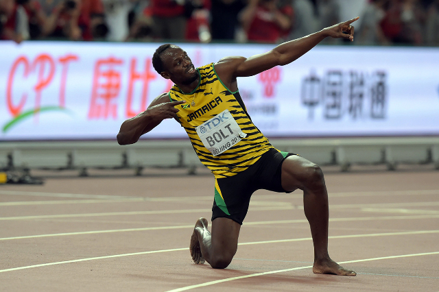 Aug 27, 2015; Beijing, China; Usain Bolt (JAM) poses after winning the 200m in 19.55 during the IAAF World Championships in Athletics at National Stadium. (Kirby Lee/USA Today Sports)