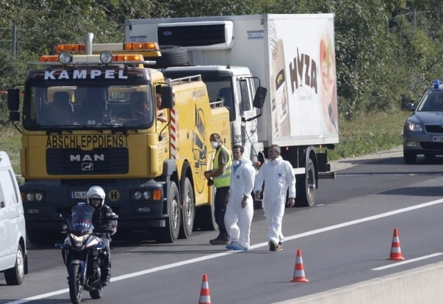 A truck in which migrants were found dead, is prepared to be towed away on a motorway near Parndorf, Austria August 27, 2015.  REUTERS/Heinz-Peter Bader