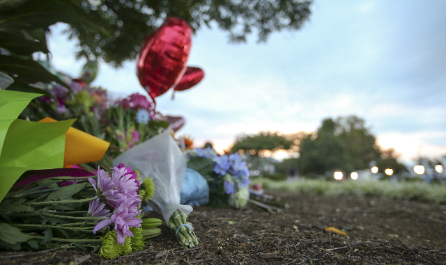 Flowers are seen at a memorial outside of the offices for WDBJ7 where killed journalists Alison Parker and Adam Warm worked in Roanoke, Virginia August 27, 2015.  REUTERS/Chris Keane