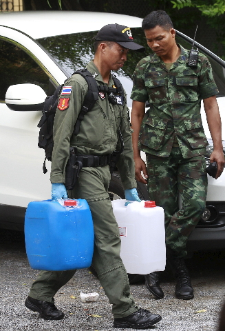 A Thai Royal Police official removes evidence from the site where a suspect of the recent Bangkok blast was arrested, in Bangkok August 29, 2015. REUTERS/Chaiwat Subprasom
