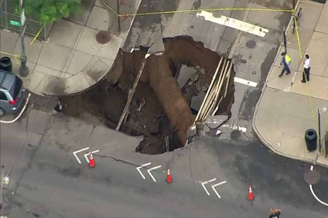 A sinkhole is seen on Tuesday, Aug. 4, 2015 in Brooklyn, New York. (Screengrab/Reuters)