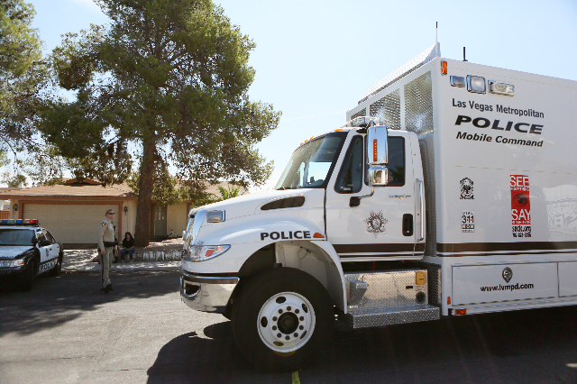 Las Vegas Metropolitan Police Mobile Command responds to an officer-involved shooting at the 6900 block of Berkshire Place Friday, Aug. 7, 2015, in Las Vegas. Police were called to a home where sh ...