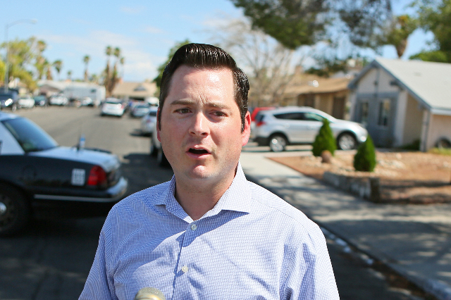 Public Information Officer Jesse Roybal speaks to the news media about an officer-involved shooting at the 6900 block of Berkshire Place Friday, Aug. 7, 2015, in Las Vegas. Police were called to a ...