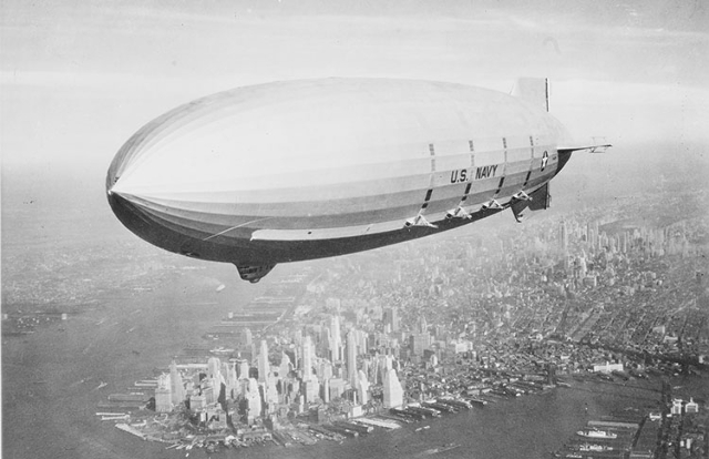 Off the California coast lies the sunken wreckage of the U.S. Navy's last flying aircraft carrier -- USS Macon, seen flying over New York in 1933. (Naval History and Heritage Command Photograph)