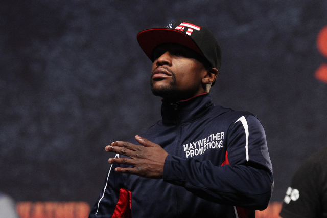 Floyd Mayweather Jr. gives a chest thumping salute to fans during the weigh in for his welterweight unification fight against Manny Pacquiao Friday, May 1, 2015, at the MGM Grand Garden Arena. (Sa ...