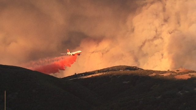 Firefighters worked Monday, Aug. 3, 2015, in steep terrain and other rugged conditions to fight California's Rocky Fire, one of nearly two dozen wildfires that have torched more than 134,000 ...