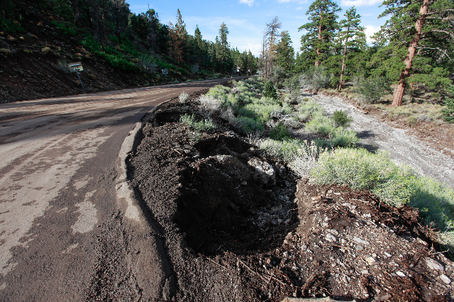 Dirt and debris is seen at the intersection of State Routes 156 and 158 following a flash flood in the Spring Mountains National Recreation Area on Friday, July 31, 2015. CHASE STEVENS/LAS VEGAS R ...