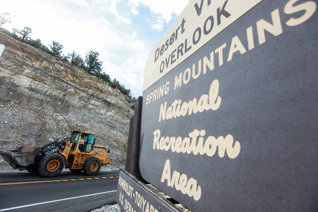 A Nevada Department of Transportation vehicle passes by during clean up along State Route 158 following a flash flood in the Spring Mountains National Recreation Area on Friday, July 31, 2015. CHA ...