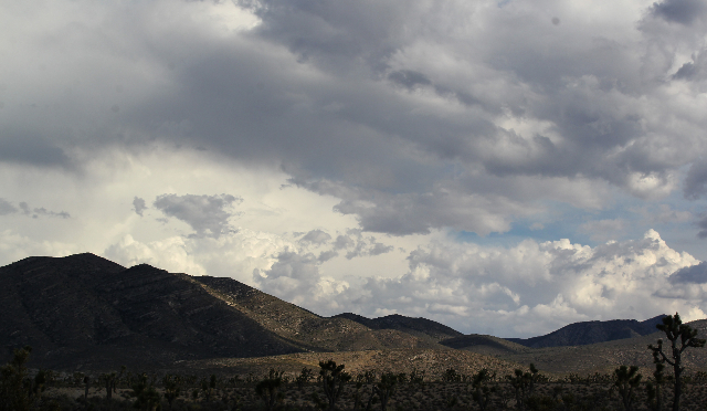 Clouds hover above the Spring Mountains National Recreation Area following a flash flood on Friday, July 31, 2015. CHASE STEVENS/LAS VEGAS REVIEW-JOURNAL Follow him @csstevensphoto