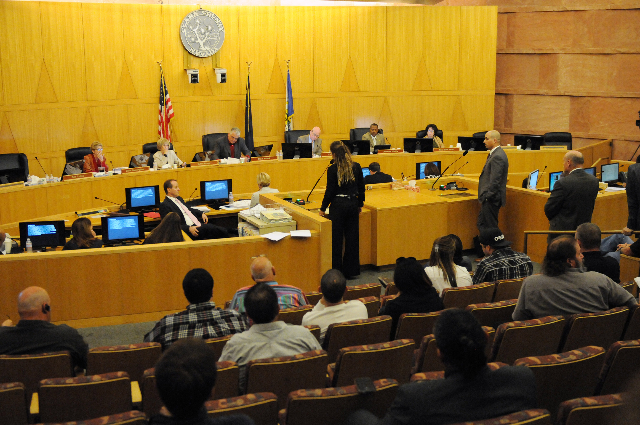 Clark County Commissioners Chris Giunchigliani, left, Susan Brager, Steve Sisolak, Larry Brown, Lawrence Weekly and Mary Beth Scow, listen to public comment during a meeting, March 19, 2014. (Erik ...