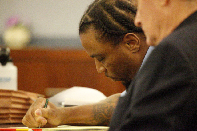 LeSean Collins, accused of the 2008 murder of Brandi Payton, takes notes during opening statements in his case at the Regional Justice Center in Las Vegas Monday, August 3, 2015. ERIK VERDUZCO/LAS ...