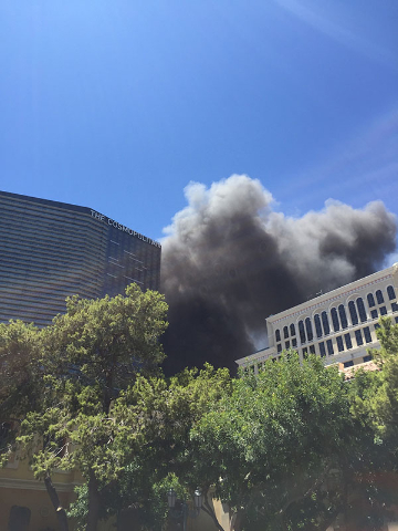 Smoke is seen rising from The Cosmopolitan of Las Vegas on the Strip, Saturday, July 25, 2015. Clark County firefighters were fighting a blaze that started in a cabana at the pool. (Joshua Dahl/La ...