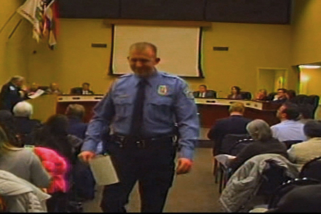 In this Feb. 11, 2014, image from video released by the City of Ferguson, Missouri, officer Darren Wilson attends a city council meeting. Wilson is the officer who shot and killed Michael Brown on ...