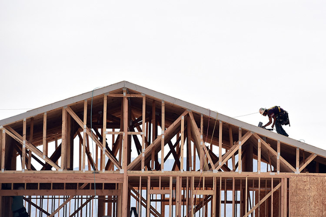A carpenter works on the roof of a new home under construction in the Montecito neighborhood at the western edge of Las Vegas on Tuesday, March 17, 2015. According to the Commerce Department, U.S. ...