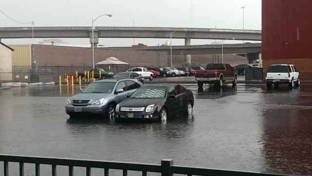 """""""Workers at the AdUs Digital Advertising Agency at the Las Vegas Review Journal were a little distracted with moving cars from the flooding parking lot!"""" (AdUS/Las Vegas Review-Journal)"""