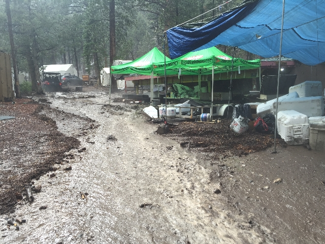 Flood waters flow through Camp Stimson on State Route 158. (Courtesy Chris Berges)