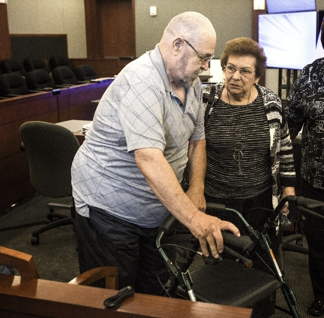 George Decou,left,  who is suffering from bladder cancer and Mary Iorio, the widow of Maurice Iorio, who died from bladder cancer complications in November 2013, talk during a break in the opening ...
