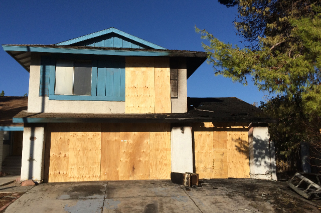 A fire in a vacant house at 5227 Jana Court caused $100,000 in damages early Monday morning, Aug. 10, 2015. (Bizuayehu Tesfaye/Las Vegas Review-Journal) Follow Bizu Tesfaye on Twitter @bizutesfaye
