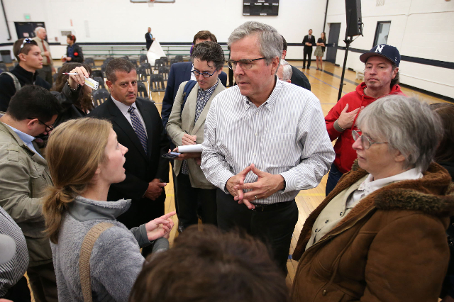 GOP presidential hopeful Jeb Bush talks with University of Nevada, Reno student Ivy Ziedrich after a town hall meeting in Reno on May 13, 2015. (Cathleen Allison/Las Vegas Review-Journal file)