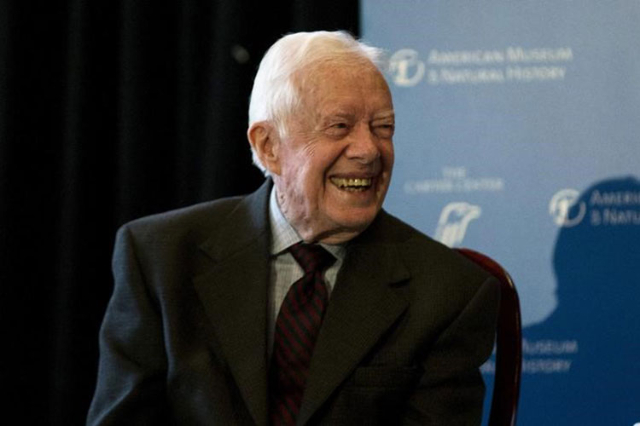 "Former president Jimmy Carter speaks at the opening of a new exhibit ""Countdown to Zero, Defeating Disease"" at the American Museum of Natural History in New York, Jan. 12, 2015. (Mike Se ..."