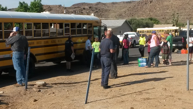 Two students and two adults were injured in a crash between a school bus and a car in Kingman, Arizona, Thursday morning, Aug. 13, 2015. (Dave Hawkins/Special to Las Vegas Review-Journal)