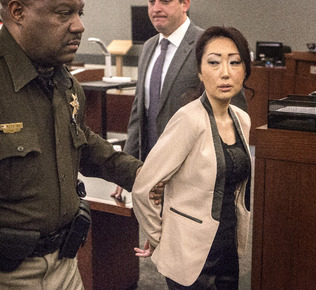 Gloria Lee, the owner of the Prince and Princess Pet Boutique, is escorted out of Clark County District Court after being sentenced on Wednesday, Feb 25, 2015  at Regional Justice Center, 2000 Lew ...