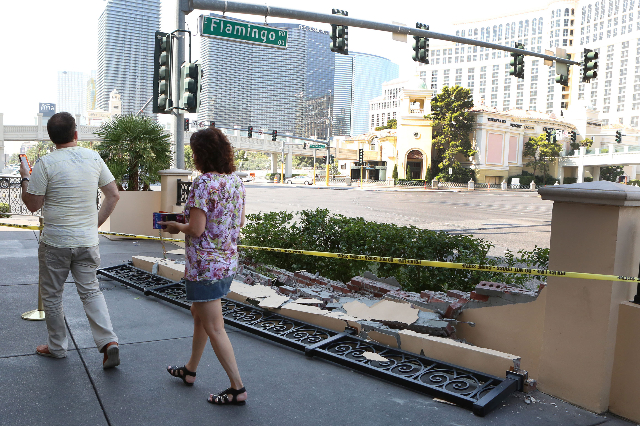 Tourists walk past a damaged wall in front of the Cromwell Hotel, 3595 Las Vegas Blvd. South, after a crash involving a Las Vegas police squad car on Wednesday, Aug. 19, 2015. BIZUAYEHU TESFAYE/LA ...