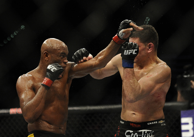 UFC middleweight Anderson Silva, left, fights with UFC middleweight Nick Diaz during their fight at UFC 183 at the MGM Grand Garden Arena in Las Vegas, Saturday, Jan. 31, 2015.(Josh Holmberg/Las V ...