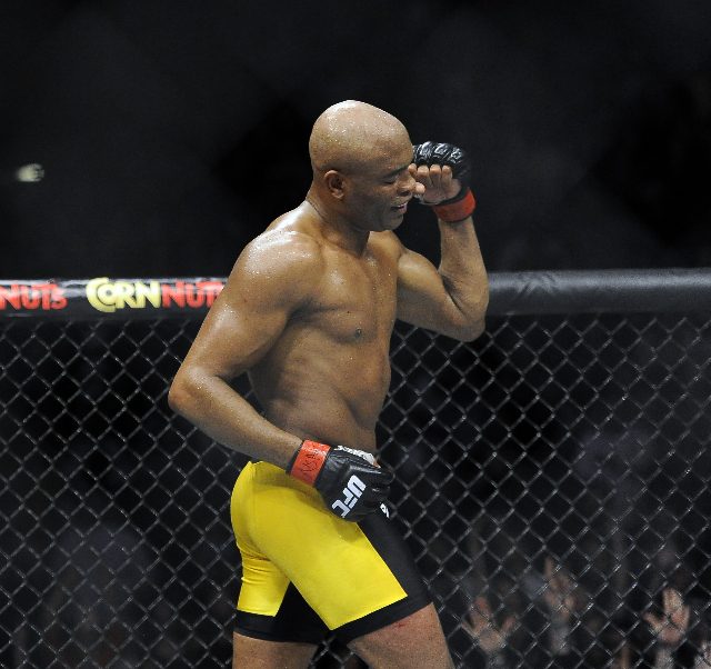 Middleweight Anderson Silva, left, fights with Nick Diaz during their fight at UFC 183 at the MGM Grand Garden Arena in Las Vegas, Saturday, Jan. 31, 2015. Silva defeated Diaz by unanimous decisio ...