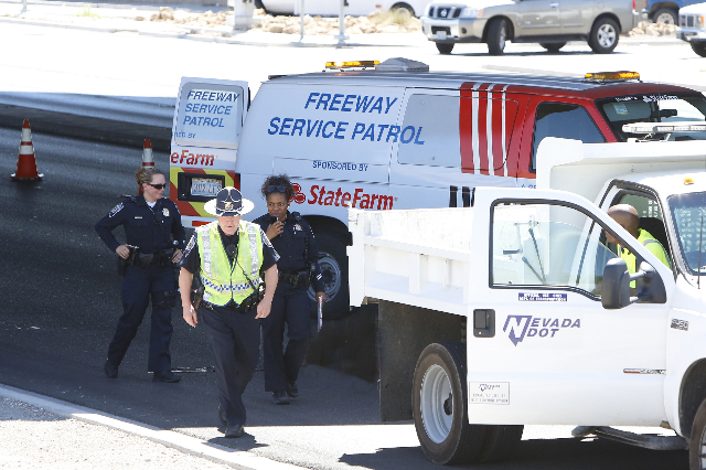 Las Vegas police are investigating near Interstate 15 after a man fell to his death from Interstate 15 onto East Lake Mead Boulevard Monday, Aug. 3, 2015. The right two lanes of westbound Lake Mea ...